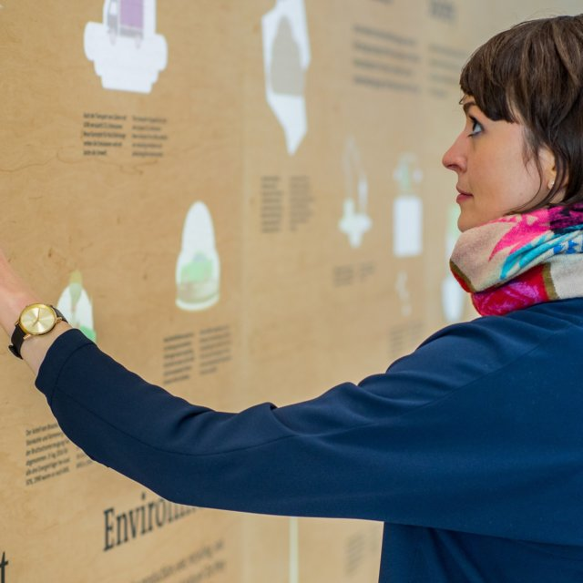 woman touch wood interactive wall projection volkswagen sustainability exhibition shift at drive forum berlin